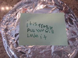 (Answer: A note and some foil that hid a banana cream pie.)