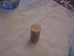 Thanksgiving cork at my table, smiling.