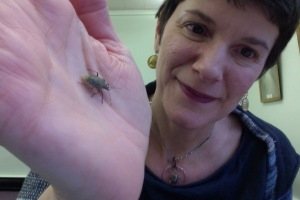 Writer with a stink bug (Antioch College Olive Kettering Library)
