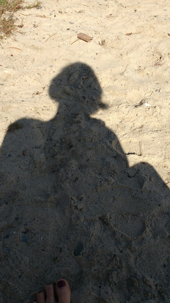 shadow of writer at Long Pond, Omega Institute, October 2017