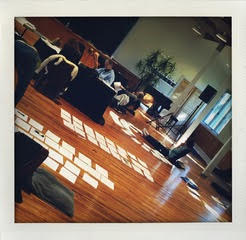 photo of papers on the floor, writing process