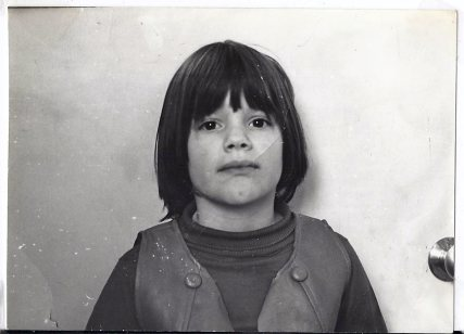 child in vest