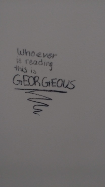"graffiti: ""whoever is reading this is Georgeous"""